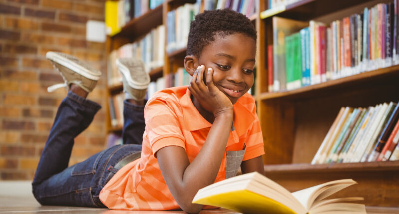 young african american boy reading