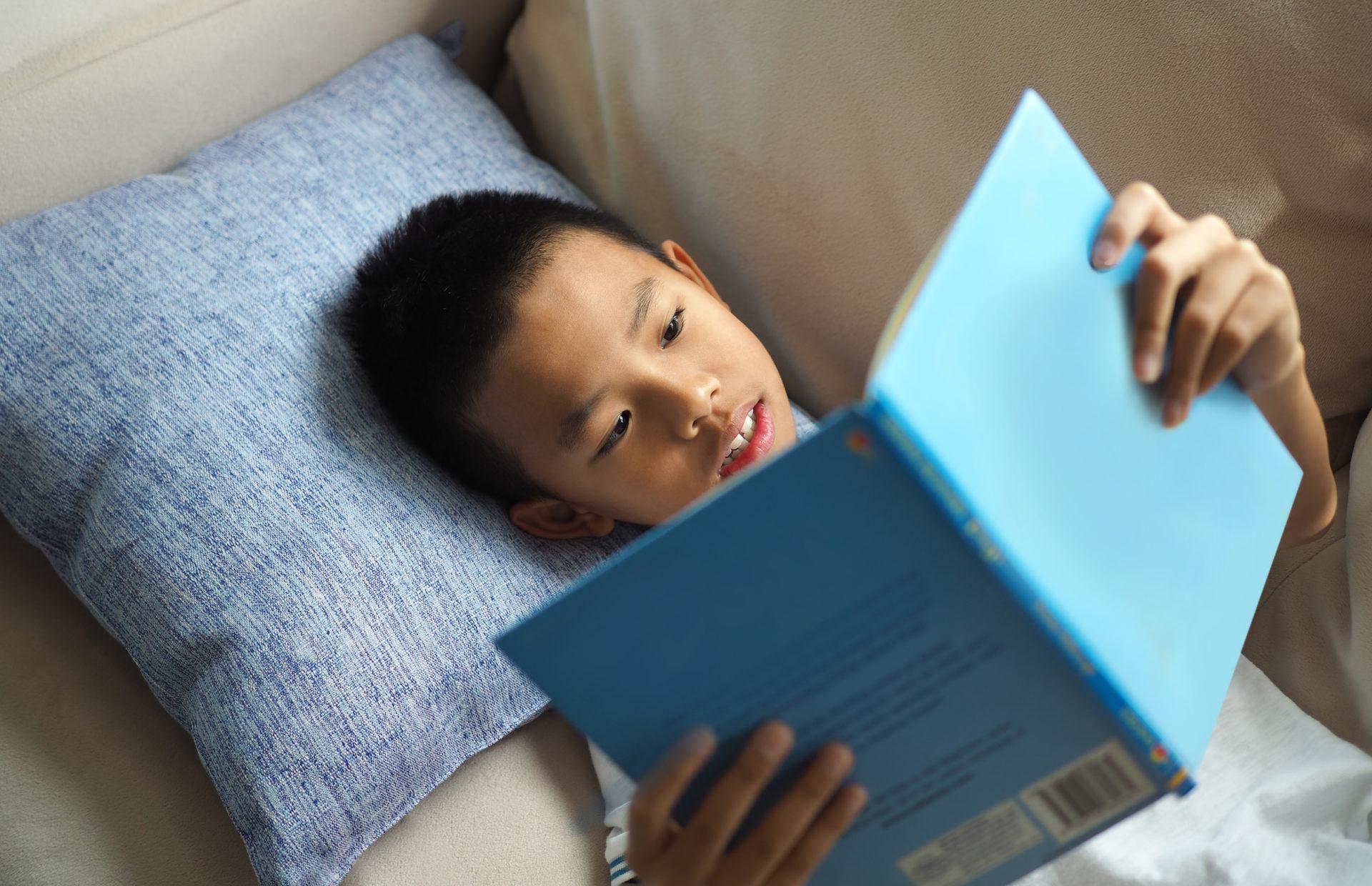 Asian boy reading