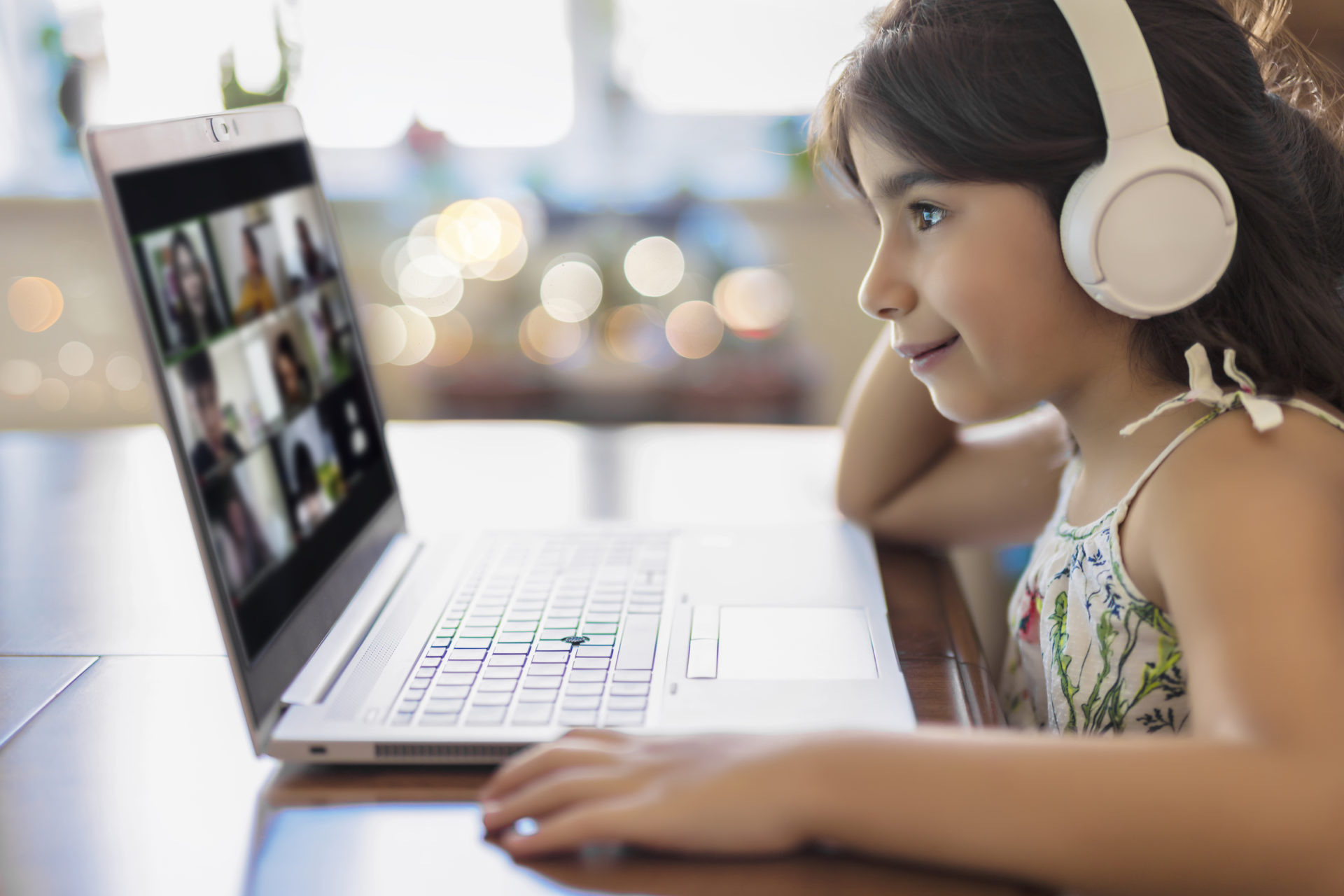 young girl with headphones learning online