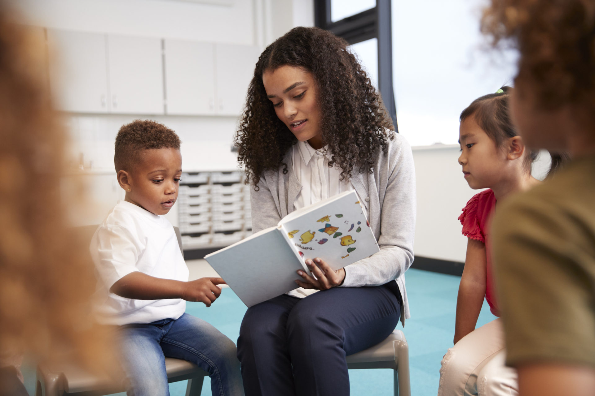 teacher reading to young children