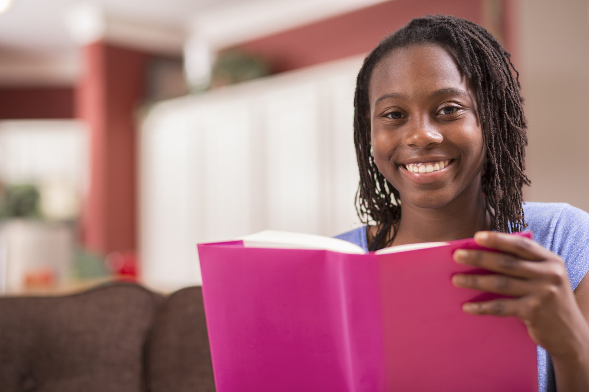 Adolescent Black girl reading a book