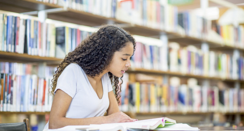 Adolescent student reading