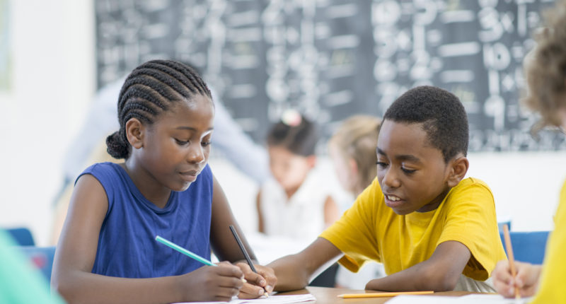 Two Black students doing math